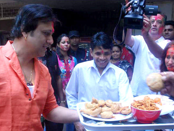 Govinda Celebrating Holi with The Members of The Media at His Buidling