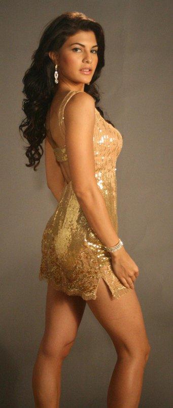 Jacqueline Fernandez Gold Color Short Dress Hot Photo Shoot