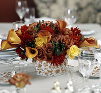 red and orange flower table centerpiece