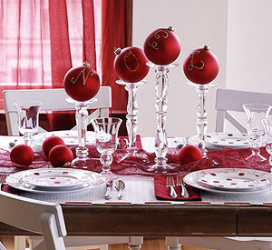 Close-up of red white Noel table setting