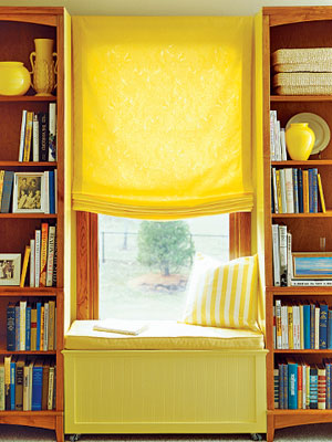long yellow shade between bookcases