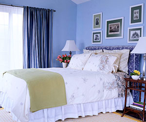 blue bedroom with upholstered headboard