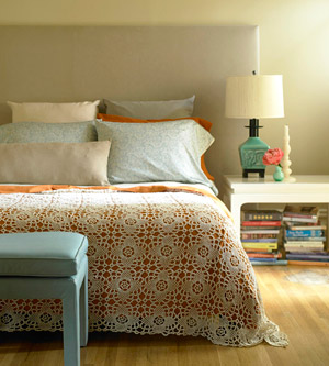 bedroom with lace coverlet