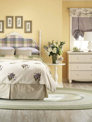 soft yellow and purple bedroom