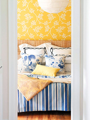 blue and yellow room with floral yellow wallpaper