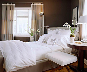 brown wall and white bedding