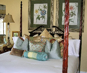 aqua, green and white bedroom with throw pillows