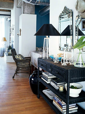 foyer with black wicker table