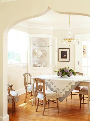 dining room with wood floors and white walls