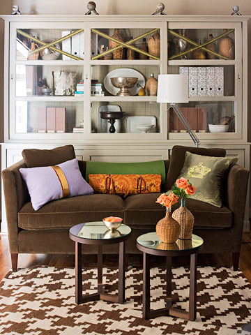 couch with pillows in front of a hutch