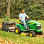 Riding mower with leaf collection attachment