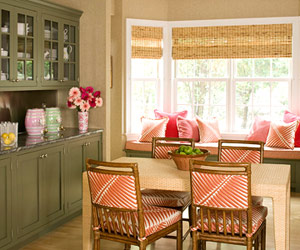 Moss-green cabinets in a large pink kitchen