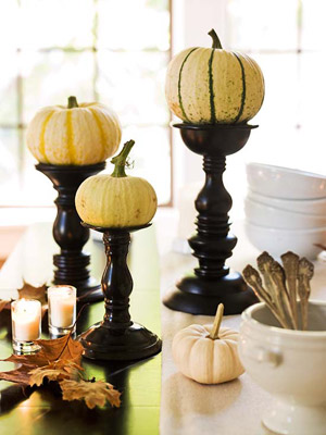 Gourds on black candle sticks