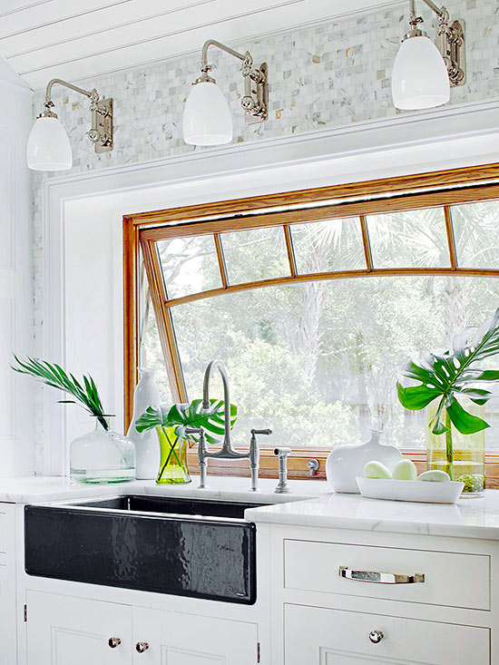 Statement Sink with Crisp White Decor and Plant Life Light Fixtures Cabinets Kitchen Countertops Black Soapstone Sink