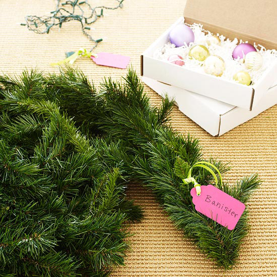 Are all of your Christmas lights in one giant tangle? Bows squashed? Garland in a knot? Here are genius ways to store & organize Christmas decorations!