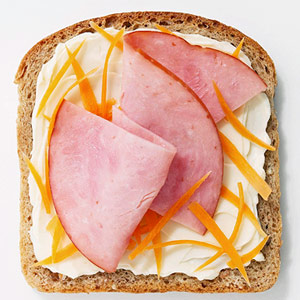 The Laughing Cow light spreadable cheese with ham and grated carrot