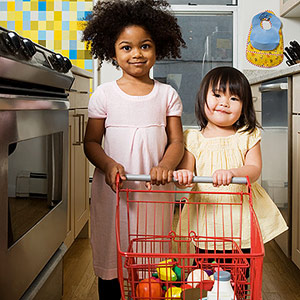 children playing with play grocery cart