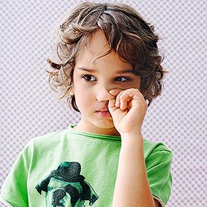 child picking nose