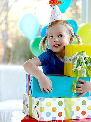 child holding birthday presents