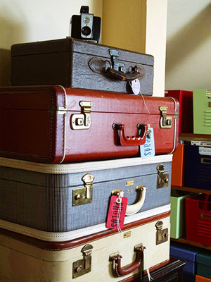 KEEP SCRAPBOOK SUPPLIES OUT OF THE WAY IN OLD SUITCASES