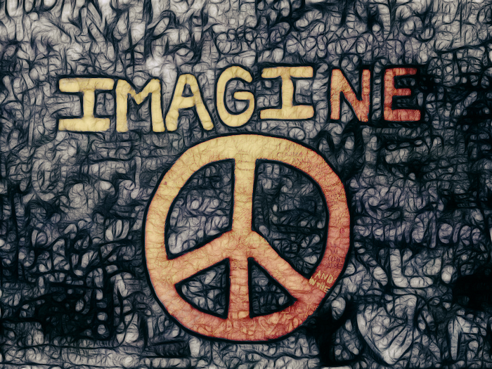 A wall that reads 'Imagine' with a peace symbol on it.