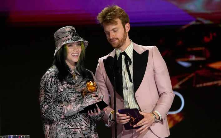 """Billie Eilish, left, and Finneas accept the award for record of the year for """"Everything I Wanted"""" at the 63rd annual Grammy Awards at the Los Angeles Convention Center on Sunday, March 14, 2021. (AP Photo/Chris Pizzello)"""