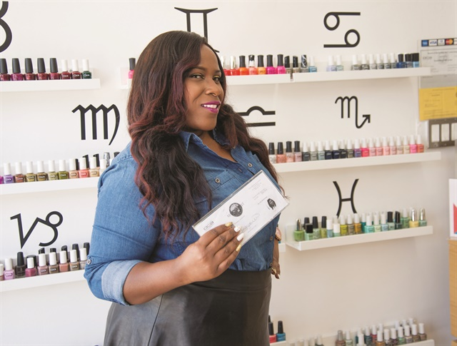 Jackson Holds Her Hard Won California Nail Tech License