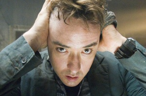 John Cusack as Mike Enslin from 1408