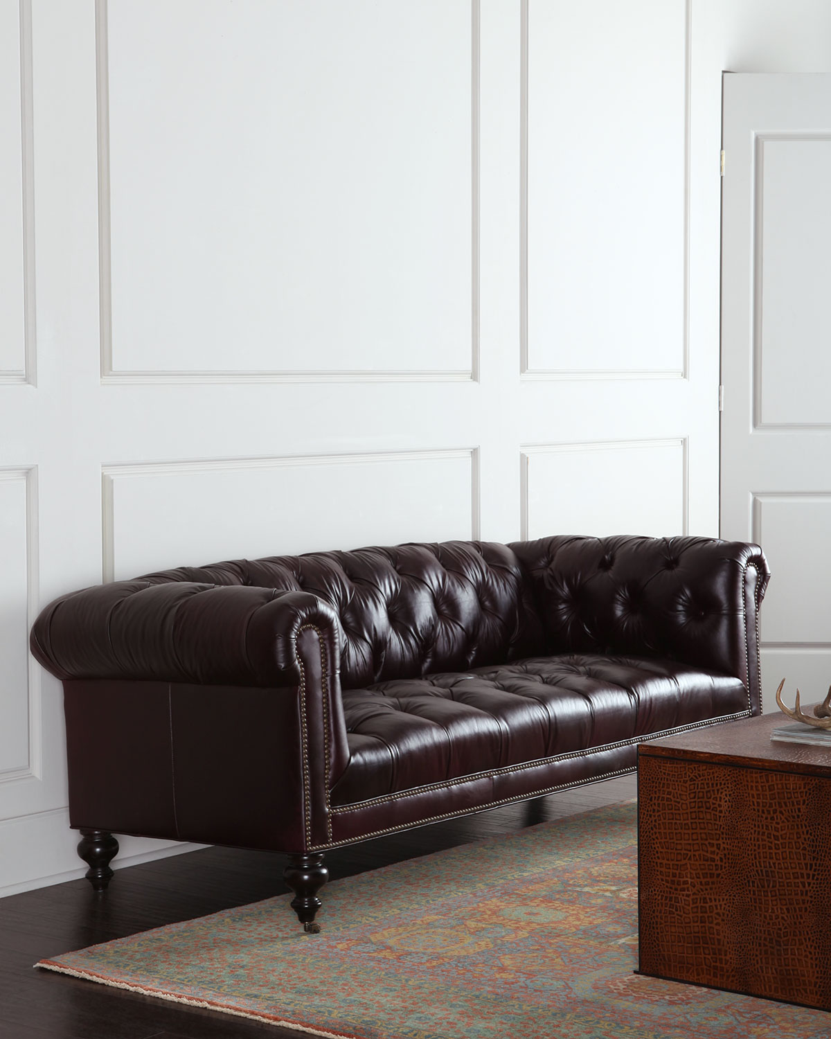 aubergine leather sofa behind corner table old hickory tannery morgan chesterfield