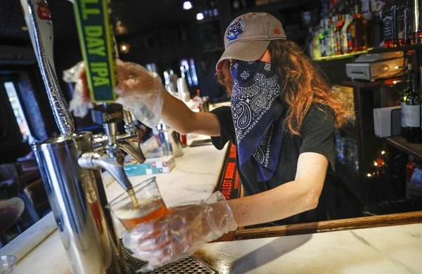 Closing bars to stop coronavirus spread is backed by science, say experts in US