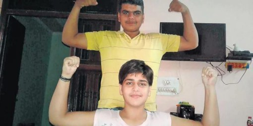 Lakra's brother helps her exercise daily.