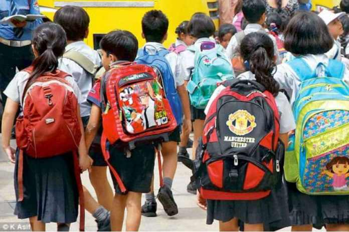 Image result for SCHOOL GIRLS IN KERALA OVER BAG WEIGHT