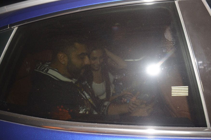 Arjun Kapoor and Malaika Arora left the eatery in the same car. In this photo, Arjun and Malaika are seen sharing sweet nothings. (Image: Viral Bhayani)