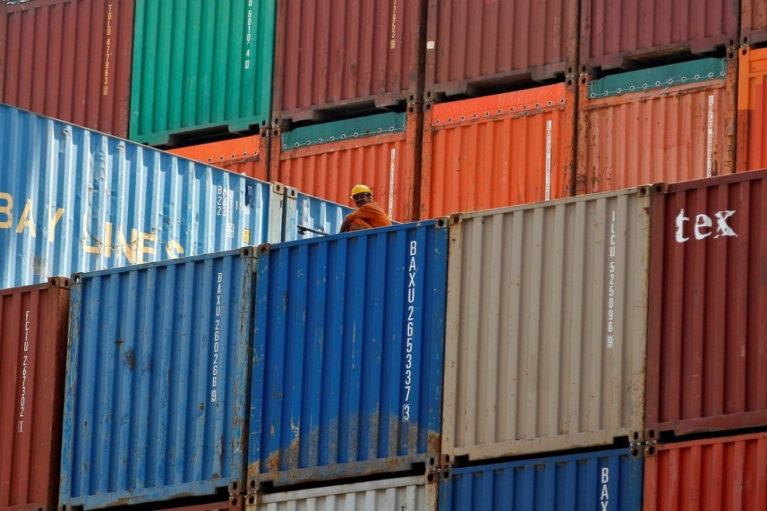 FILE PHOTO: A worker sits on a ship carrying containers at Mundra Port in Gujarat, April 1, 2014. (REUTERS)