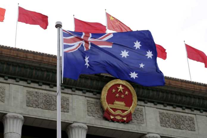 FILE PHOTO: The Australian flag flutters in front of the Great Hall of the People during a welcoming ceremony for Australian Prime Minister Malcolm Turnbull (not in picture) in Beijing, China, April 14, 2016. REUTERS/Jason Lee