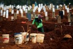 In Indonesia's Java, Punishment for Not Wearing Masks is Digging Graves for Covid-19 Victims