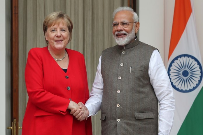 File photo: German Chancellor Angela Merkel shakes hands with India's Prime Minister Narendra Modi ahead of their meeting at Hyderabad House in New Delhi, India, November 1, 2019. (REUTERS/Adnan Abidi)