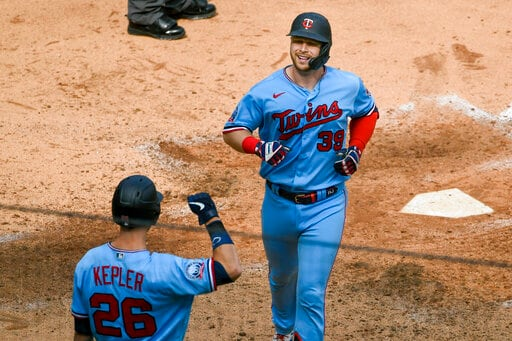 Minnesota Twins' Ryan Jeffers, right, smiles as he is congratulated by Max Kepler after hitting a two-run home run off Cleveland Indians pitcher Cal Quantrill during the fifth inning of a baseball game Sunday, Sept. 13, 2020, in Minneapolis. (AP Photo/Craig Lassig)