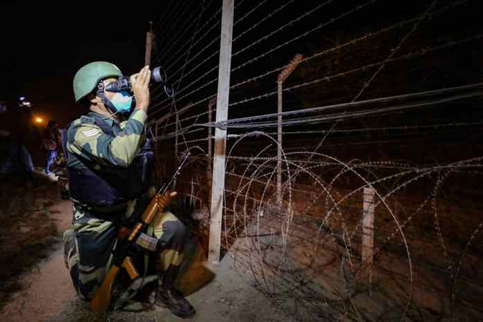 A Border Security Force (BSF) personnel patrols near India-Pakistan international border, on the outskirts of Jammu, on November 14, 2020. (PTI Photo)
