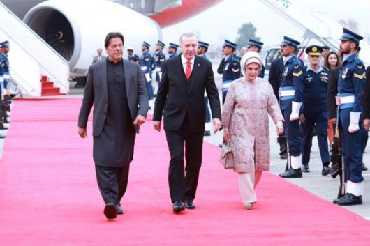 Pakistan Prime Minister Imran Khan walks with Turkish President Tayyip Erdogan on his arrival in Islamabad, Pakistan on February 13, 2020. (Reuters)