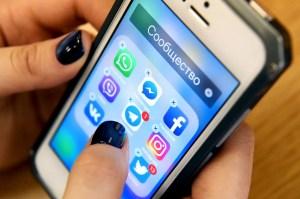 Hand using mobile phone