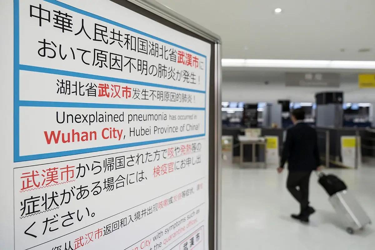 Sixth person dies as Wuhan coronavirus spreads between people ...