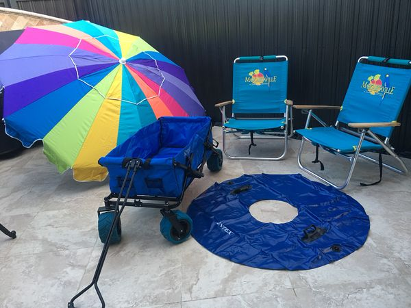 margaritaville chairs for sale chair 1 2 slipcover beach wagon oversized rainbow umbrella