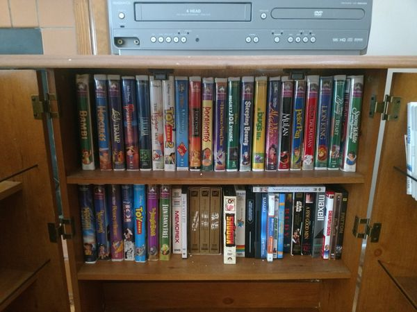 Disney VHS collection movie cabinet and VHSDVD player