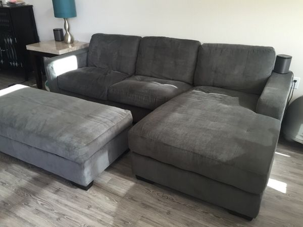 gray sofa with chaise lounge extra long canada couch sectional w storage ottoman for sale in