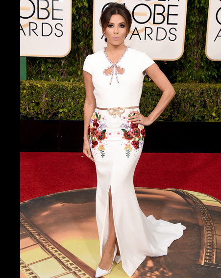 Actress Eva Longoria makes sure all eyes are on her in this embroidered figure hugging dress [Getty]