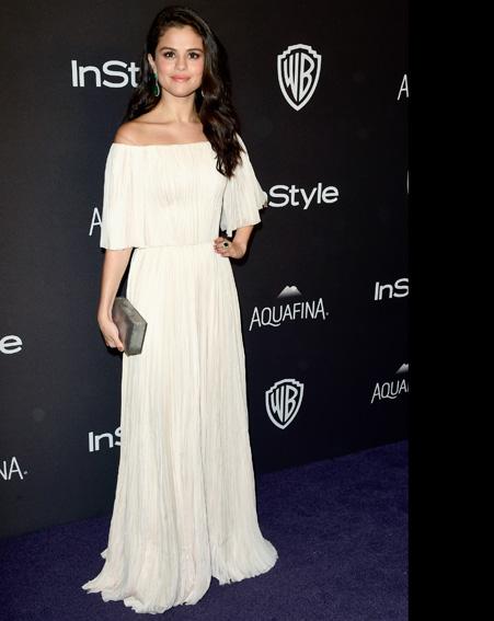 Selena Gomez  looks angelic in this white dress [Getty]