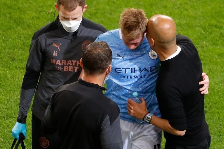 De Bruyne is consoled by Guardiola.