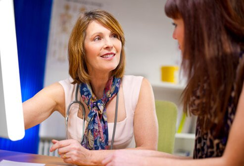 A female doctor and patient discuss hepatitis C (hep c).