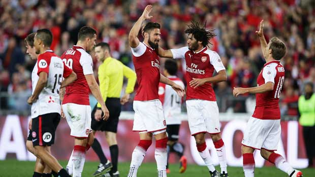 Arsenal players celebrate Olivier Giroud's goal against the Wanderers.